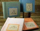 plant dyed linen photo albums with embroidered patch:  by kata golda