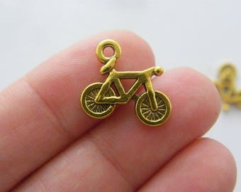 10 Bicycle charms antique gold tone GC71