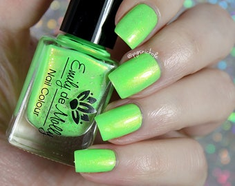 "Nail polish - ""Room For More"" a neon green with copper shimmer and silver flakes"