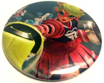 Handmade POCKET MIRROR made using recycled magazines -Arms- 2.25 inches - OOAK - One of a Kind