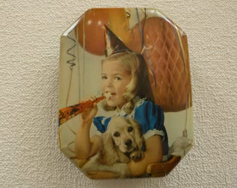 Vintage Blue Bird Confectionery Tin (England) Featuring a Little Girl Holding a Puppy at a Birthday Party.