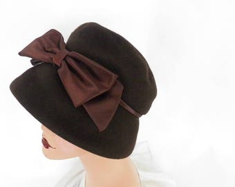Woman's 1960s hat, brown bucket with satin bow