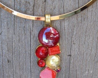Red clay pendant with glass and rhinestone mosaic