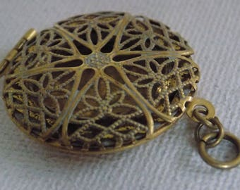 Antique locket pendant with enamel and gold plated filigree star and floral motif, antique jewelry