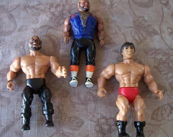 Vintage group of three action figures.  C1-649-1.5.