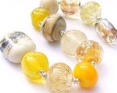 Lampwork orphan beads - set of 12 mainly cream and yellow renegades