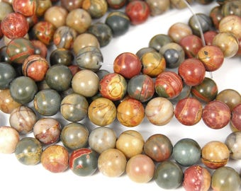 Red Creek Jasper 6mm smooth round -15.5 inch strand