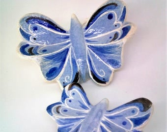 Two ceramic butterfly. Wall hanging stoneware sculptures .