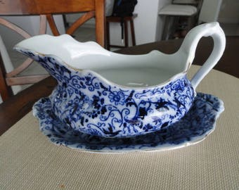 D096)  Antique Flow Blue Ironstone Gravy Boat with Plate Mercer Pottery Nassau
