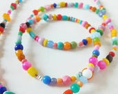 a colourful boho beaded necklace long...