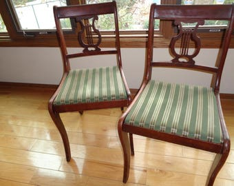 2 Vintage Lyre Back Mahogany Wood Side Chairs in the original stained finish and original upholstery covered chair seats in Good Condition