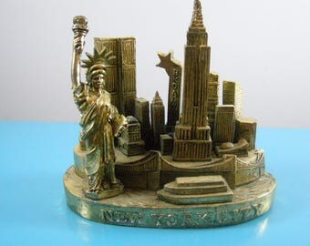 New York City Skyline Paperweight. Twin Towers, Statue of Liberty, Empire State Building, Broadway, NY Harbor. Heavy Gold Colored Cast Metal