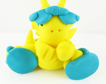 Clay yellow dragon with flip flops and sunglasses