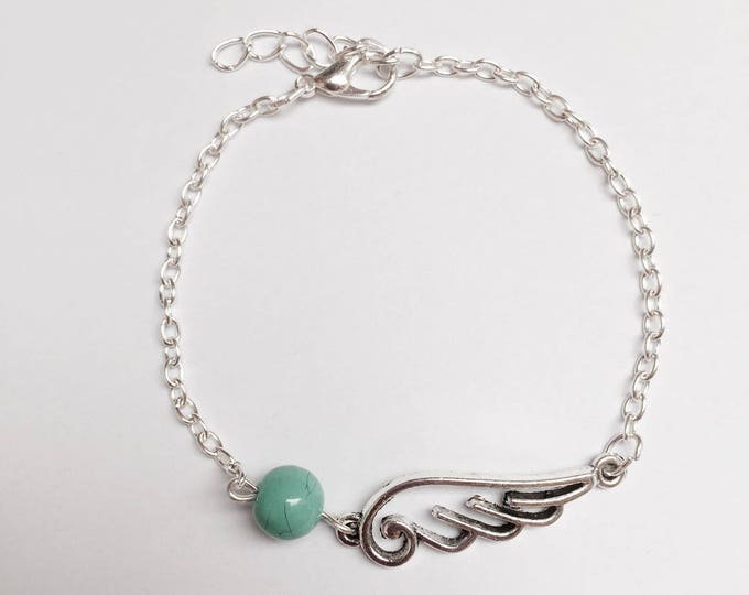 Silver wing and Pearl chain bracelet