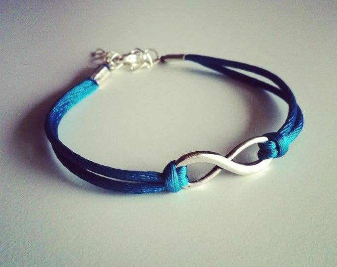 Bracelet large teal cord with Infinity sign
