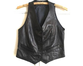 black leather vest | sm