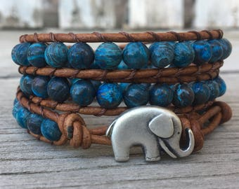 blue beaded leather wrap bracelet with blue sky jasper stones and light brown leather lucky elephant