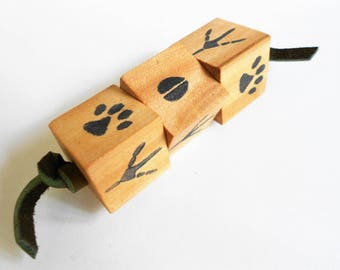 Wood puzzle cubes of matching woodland animal tracks for travel and quiet play old fashioned fidget