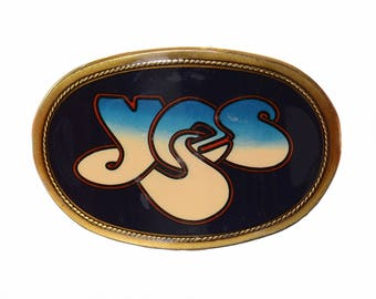 Vintage 1977 YES Rock Band Belt Buckle 1970s Pacifica Mfg Brass Tone and Plastic Psychedelic Rock and Roll Music Belt Buckle