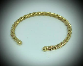 Brass twisted cuff bracelet with fused ends. To fit wrist sizes 5.5 to 6 inches.