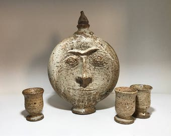 Stoneware sun decanter and cups