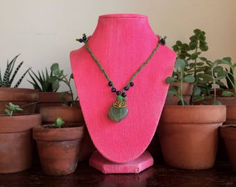 Chain and macrame becklace with a gold tone lotus charm, blue and green JADE and indian agate