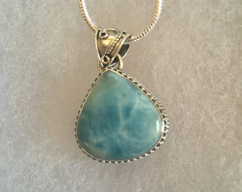 Larimar gemstone pendant set in a sterling silver design.