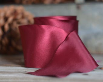 30 yard roll of burgundy single faced satin