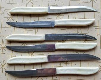 Quikut Stainless Steak Knives Set of 6 White Marbled Plastic Handles