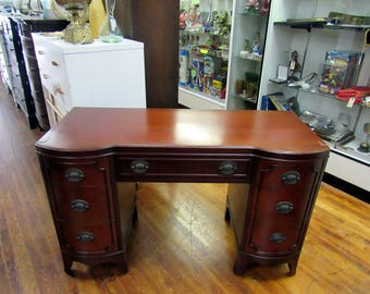 Mahogany Desk with seven drawers and curved front