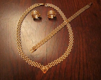 Avon Gold Tone Set of Necklace, Bracelet, and Earrings