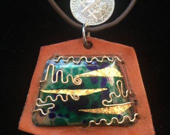 Enamel and leather pendant with gold