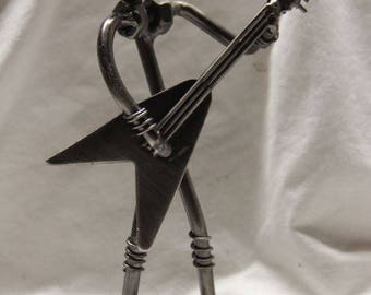 Miniature guitar player novelty figurine.  All metal