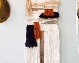 Woven wallhanging in rust, charcoal , cream and blush