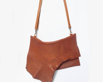 Cognac leather clutch with irregular flap