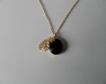 Black Oval Pendant and gold leaf necklace
