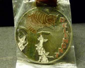 "Delemont Watch Co. ""Treed"" Watch Fob-  Dogs and Raccoon."