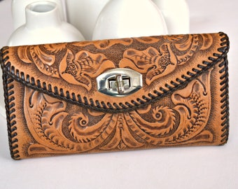 Amazing vintage tooled brown leather wallet.