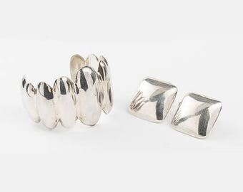 Mexican Sterling Silver Cuff Bracelet Signed coupled with a pair of Mexican sterling silver earrings. Total approx. weight: 2.45 TOZ.