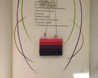 Long necklace with wooden charm of colored pencils in different shades of pink and purple