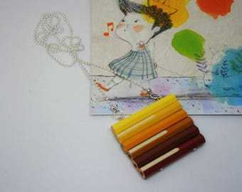 Wooden long necklace with colored pencils in shades of yellow and Brown
