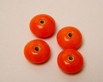 Glass beads, shaped discs, orange, 7 x 11 mm by 4 pieces