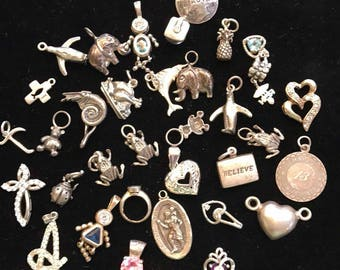 Old sterling silver charms