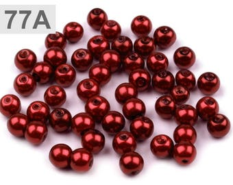 A 77 - 50 g of round 6 mm glass pearl beads