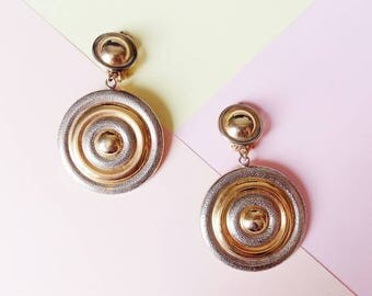 Vintages dangle Earrings clip on, gold and silver ring in a spiral from the 80's
