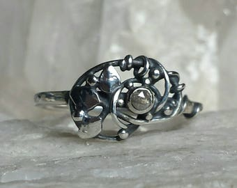 Sterling Silver Intertwined Leaf Ring set with a rose cut Diamond