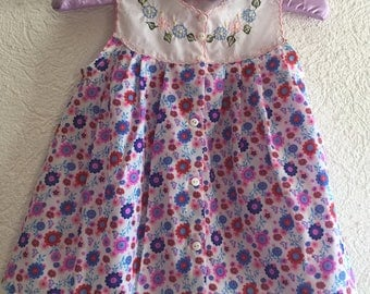 Girl's Mexican dress  embroidered with Flowers and matching headband.