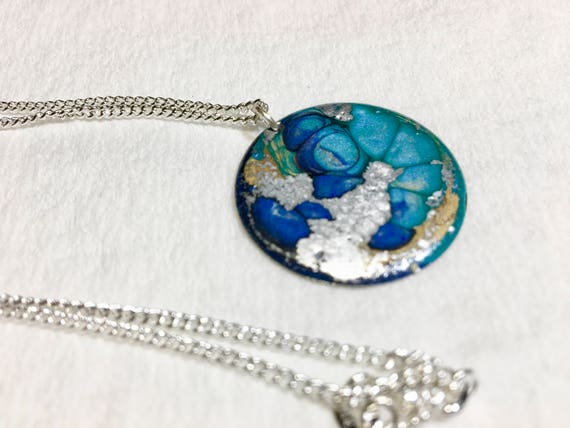 Handmade necklace with abstract design round  silver plated enamel painted (blue/turquoise/silver) pendant with sterling silver chain.