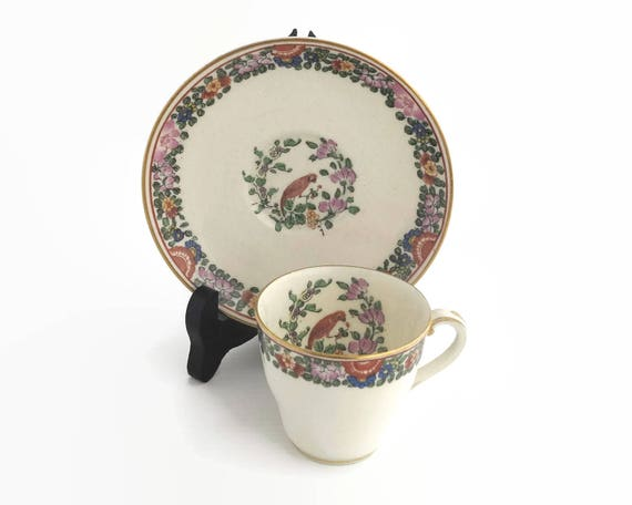 "Antique Royal Worcester demitasse cup and saucer with ""Old Worcester Parrot"" pattern, parrot and flowers, parrot inside cup, England, 1925"