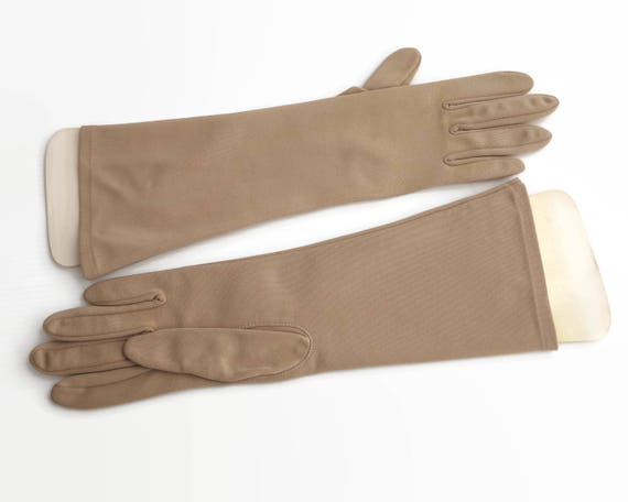 Vintage light brown longer length gloves, dead plain, one size fits most, nylon, original packet with cardboard hands, circa 1960s